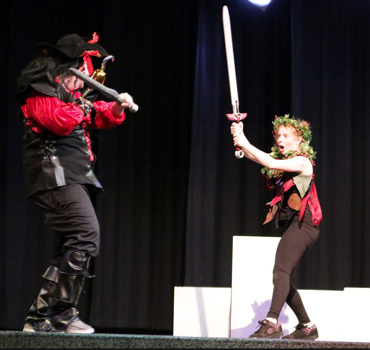 Captain Hook (played by senior JT Stawarz) and Peter Pan (played by senior Danielle Marshall) duel. Photo by Ian Kelty.