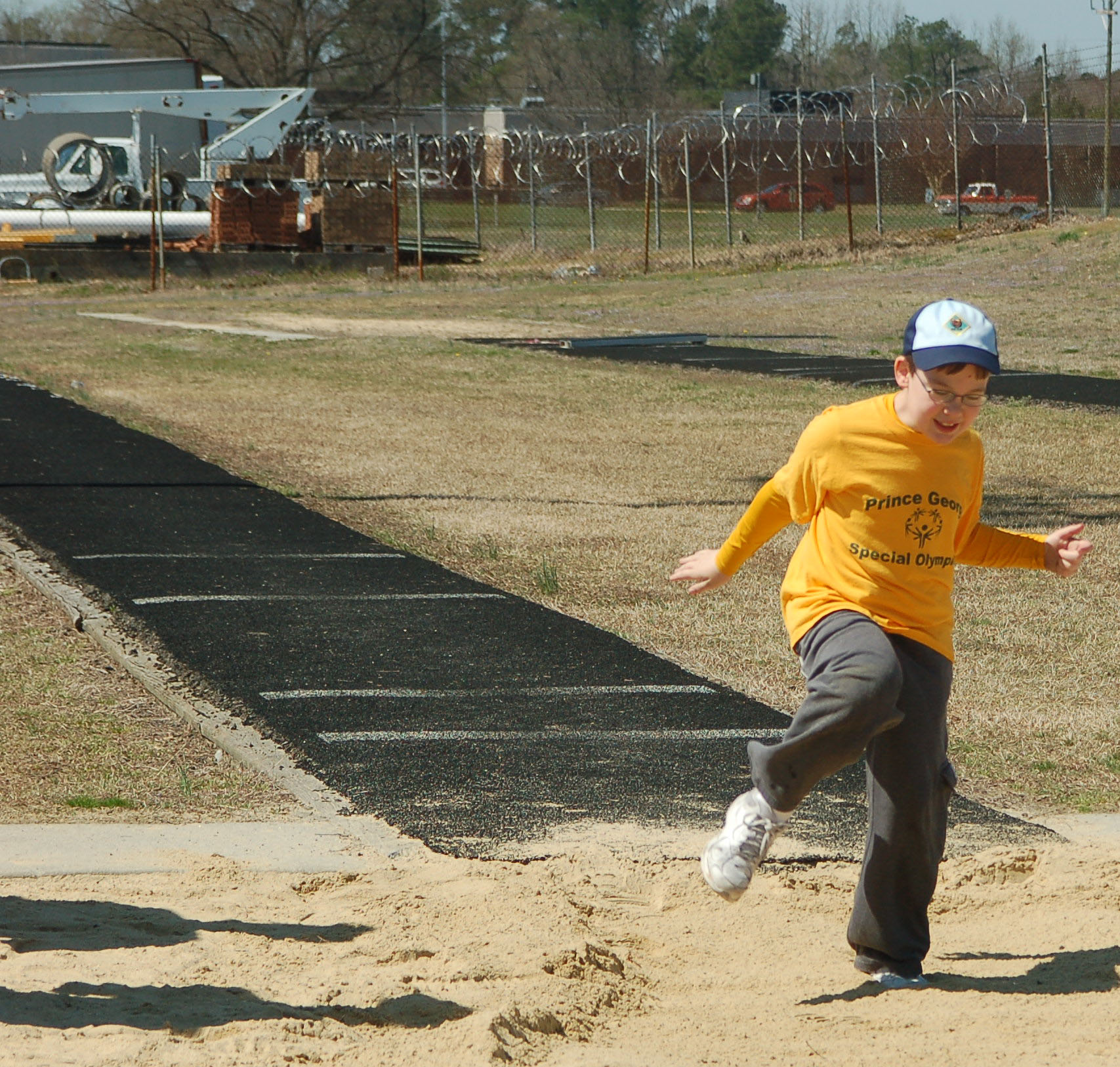 An ID student participates in the long jump. Photo by Travis Temple.