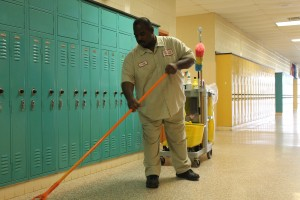Head Custodian Bryan Griffin  mops up water leaked  onto the floors during the latest snow storm. Classrooms  in  A and B-wing  have leaked the most during this year. Ceiling tiles must be removed until the roof is fixed.  Photos by Rosemarie Hopkins and Angelica Martinez.