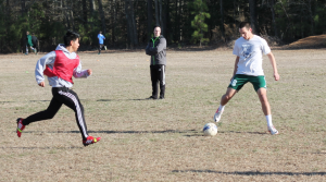 Alumnus Cameron Smith maintains possession of the ball while being defended during last year's boys soccer tryouts. Photo by Daniel Puryear.